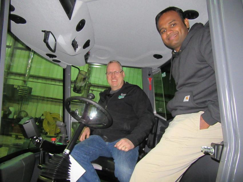 Inside the cab of this Dynapac CA1500D single drum vibratory roller, Scott Ferguson (L), Flynn Brothers Contracting's fleet manager, receives a review of the Dynapac Seismic display from Dynapac's Vijay Palanisamy.