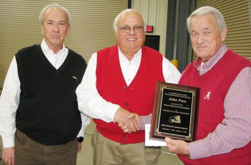 (L-R): Warrior Tractor's David Pearson and Gene Taylor present John Fore with a plaque and a vehicle title.