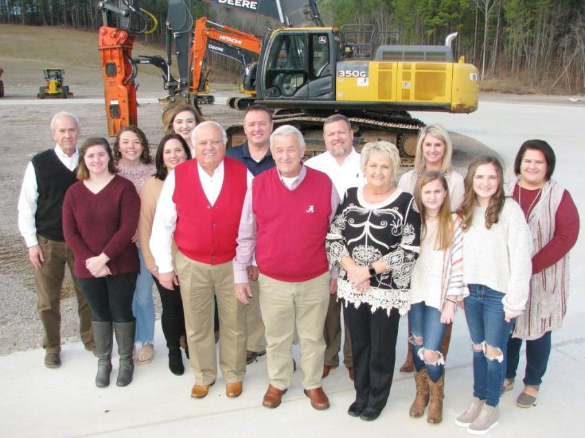 John Fore (C), flanked by his wife, Helen, on the right, Warrior Tractor owner Gene Taylor on the left and branch manager David Pearson on the far left, are joined by a big group of the Fore family members who were able to make it out to the celebration in Graysville.