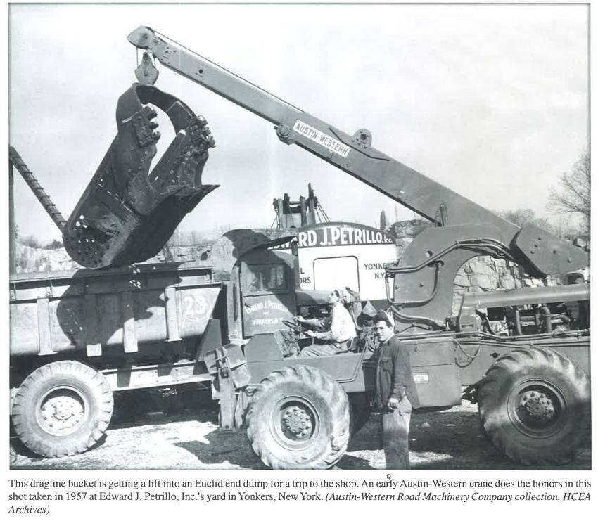 This dragline bucket is getting a lift into an Euclid end dump for a trip to the shop. An early Austin-Western crane does the honors in this shot taken in 1957 at Edward J. Petrillo I (Austin-Western Road Machinery Company collection photo, HCEA Archives)
