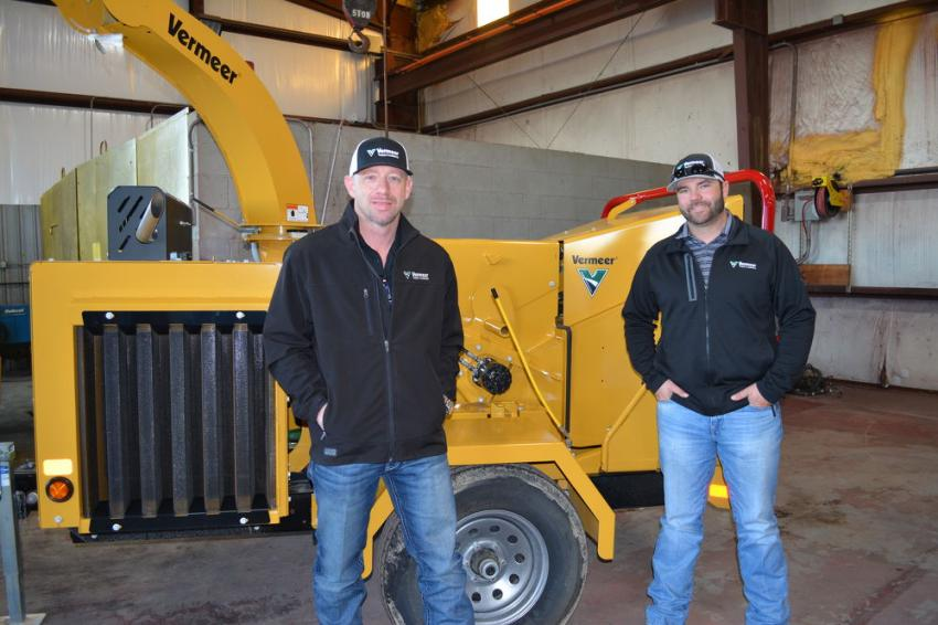 Vermeer Texas-Louisiana Gulf Coast GM Mark Foulon (L) and sales rep. Kurt Spoor with the Vermeer BC-1000XL chipper at the Vermeer open house in Victoria.