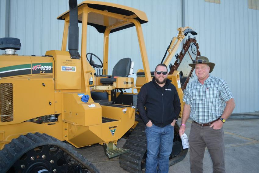 Justin Harper, regional manager for Compact Construction Equipment, which owns Bobcat dealerships throughout Texas, along with Jeff Yates. Yates is with Belltec, a manufacturer of auger and drill attachments.