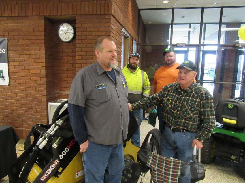 (L-R): Fred Ott, Mike Brown, Dominic Kitts and Justin Hale of Deppen Farms look over this Boxer 600HD compact utility loader on display at the Expo.