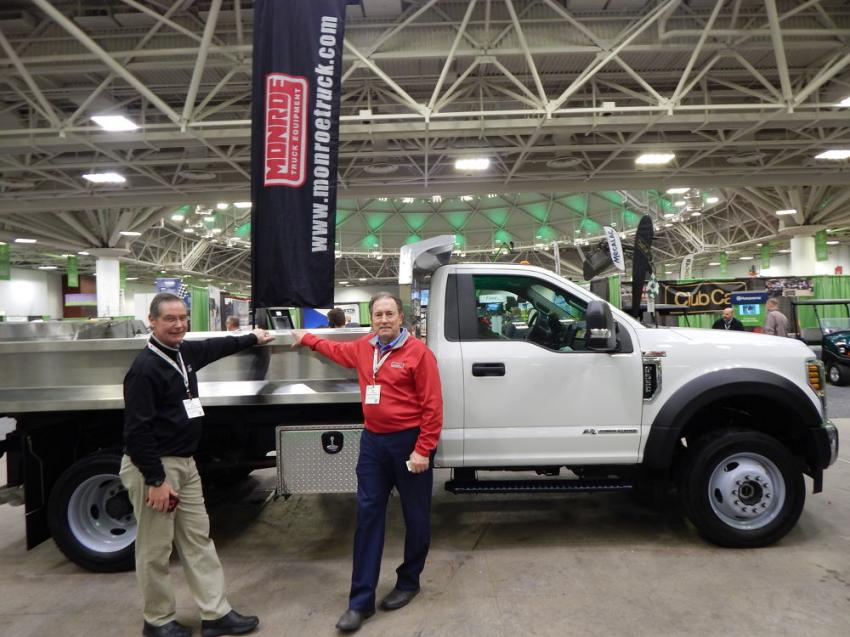 Jim Schneider (L) and Jeff Hippert, territory sales representatives of Monroe Truck Equipment, Monroe, Wis., and their decked-out Boyer Ford 2019 F-550 Super Duty with MTE-Zee 11-ft. dump body and plow package.