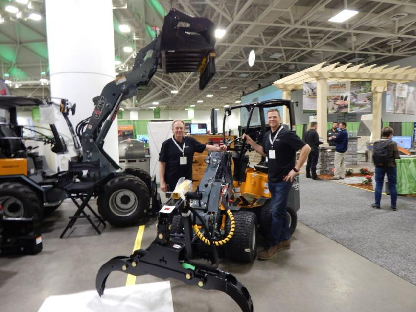 Dave Nordgaard (L), owner of Branch Manager and inventor of the mini-grapple, and Mike Hagan, sales manager, display the company's urban tree and brush mini-grapple. It works perfectly with many articulated loaders like the Giant product lines.