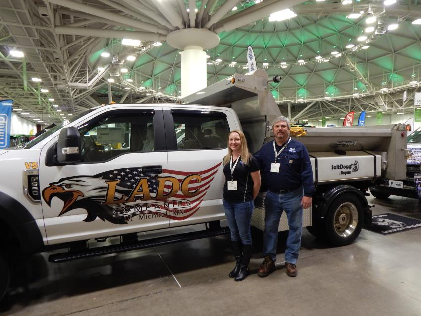Adele Harris and Steve Bergman of Twin Star Equipment, St. Michael, Minn., had a huge booth area and many truck options on display for contractors and landscapers. This Ford F550 from Pritchard Commercial Sales, Minneapolis, Minn., is outfitted with a Buyers MDS 9-ft. landscaper body and salt spreader with a built-in, roll-top tarp system.