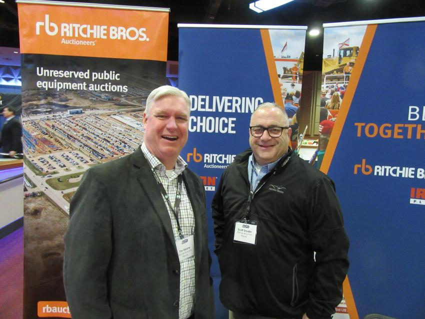 Ritchie Bros' Tim Keane (L) and Scott Snyder spoke with attendees about the company's auction services and upcoming auctions.
