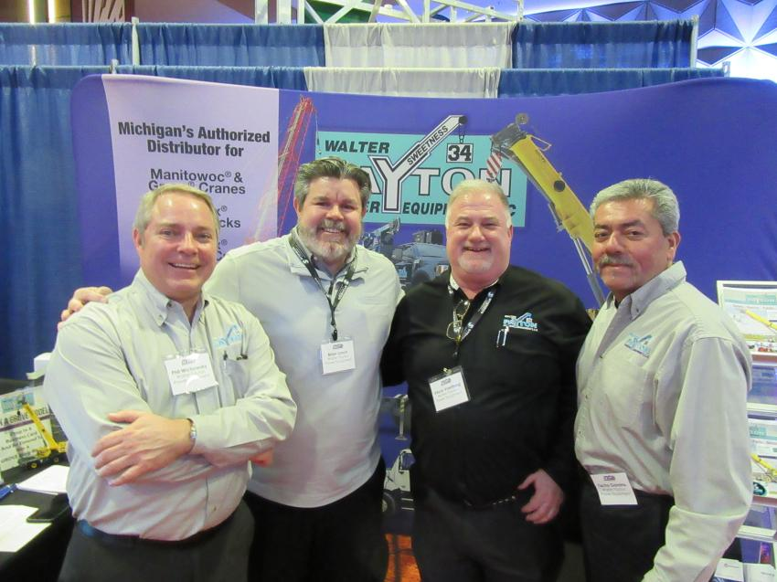 (L-R): First-time exhibitors at the MITA Conference, Walter Payton Power Equipment's Phil Wichowsky, Brian Lynch, Vince Voetberg and Tacho Gamino, greet attendees at their booth.