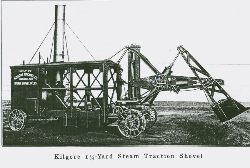 The Kilgore Direct acting shovel is on cleated traction wheels for use off the rails.