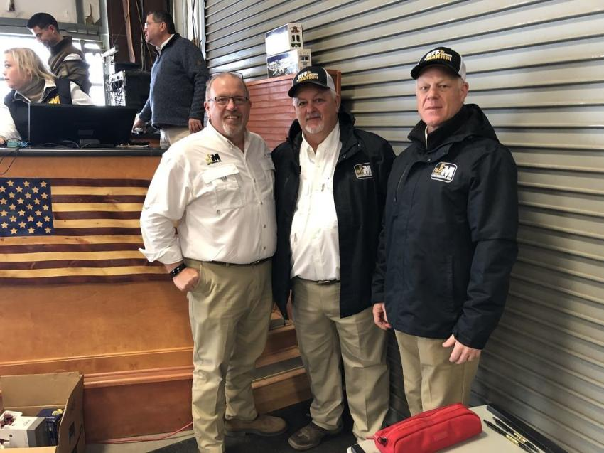 (L-R): Jeff Martin with Steve Ryals and Todd Nelson, all of Jeff Martin Auctioneers, go over a few items before the auction begins.