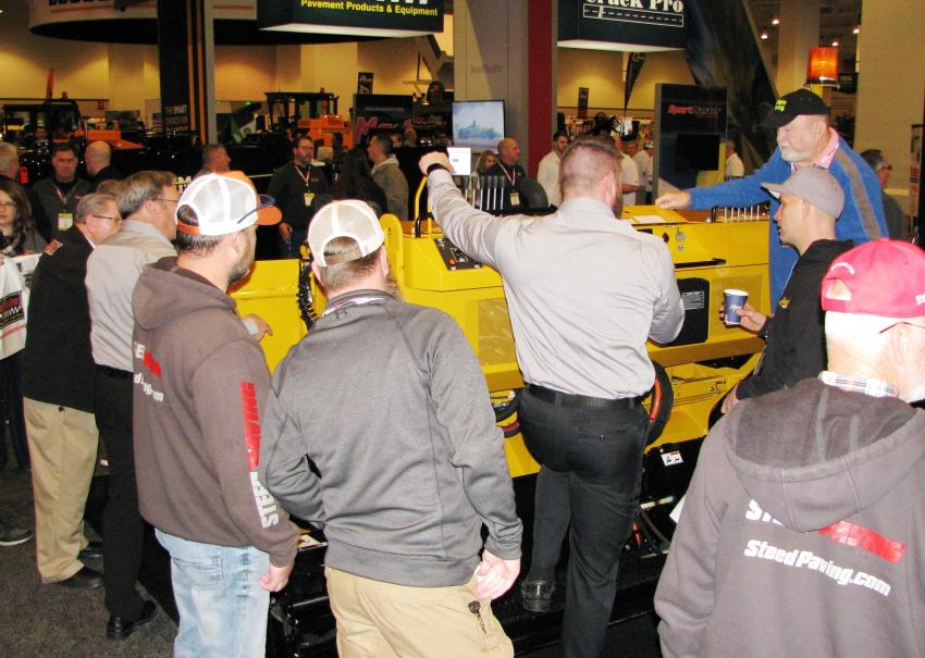 Somewhere underneath that crowd on the show floor is a Weiler P65 paver.