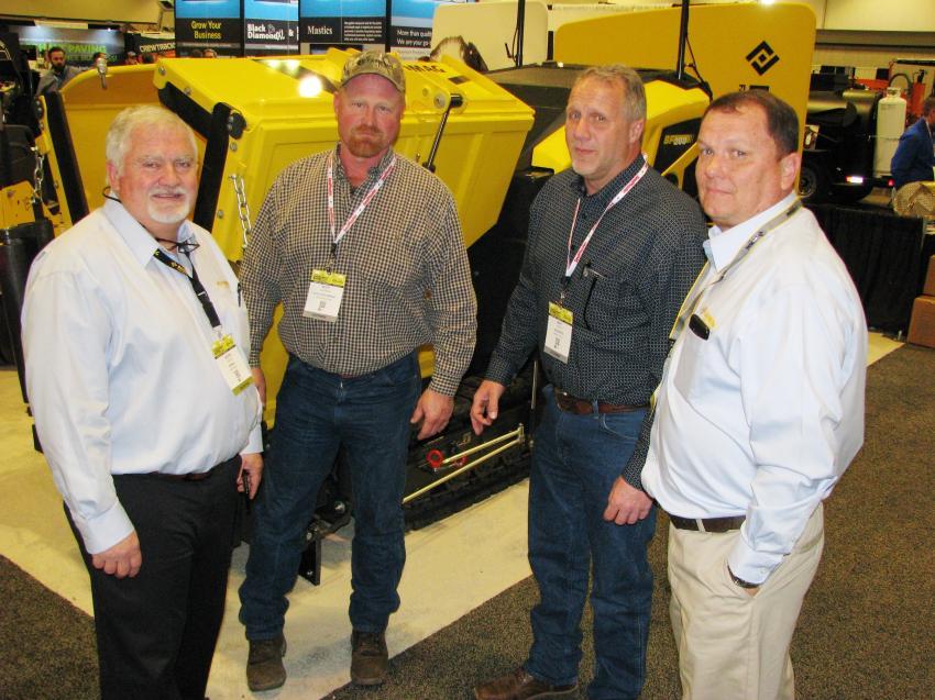 (L-R): Austin Miller of Bomag, Ridgeway, S.C.; Scott Uchtman and Matt Pettit of Van Keppel, Kansas City, Kan.; and Henry Polk of Bomag discuss the brand new Bomag BF 200 compact asphalt paver.
