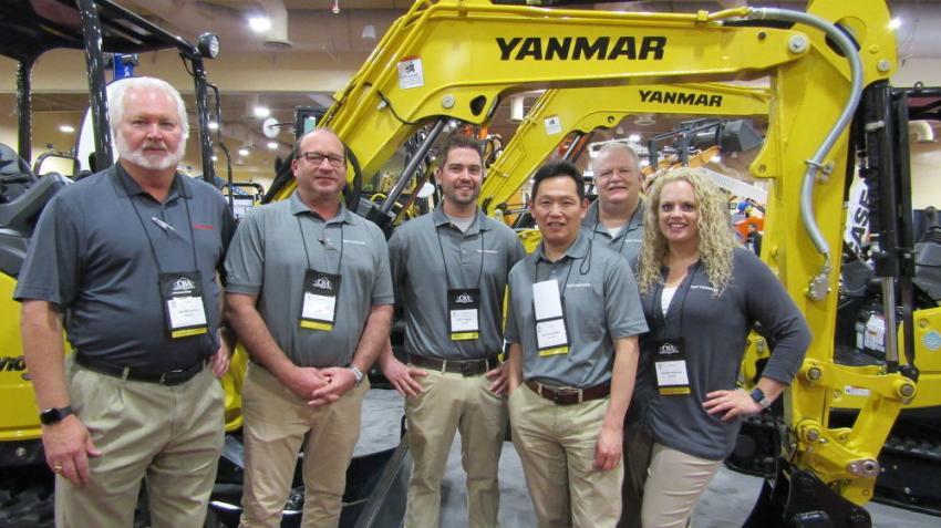 (L-R): Representatives Dale McLemore, Darren Wallace, Taylor Ingram, Kenji Kuramoto, Ralph Picken and Jennifer Shannon of Yanmar exhibit their number one selling machine the Yanmar ViO35 mini-excavator.
