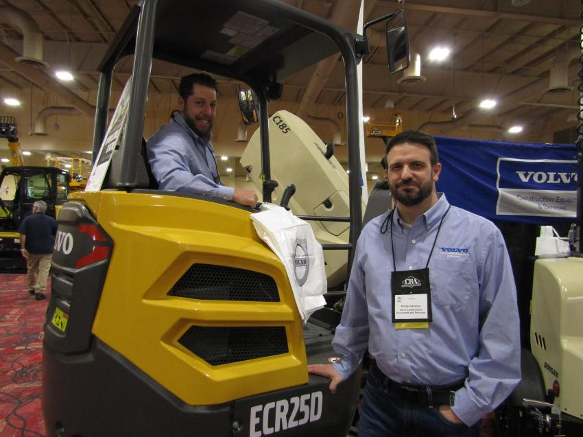 Scott Nadell (seated) and Phillip Ransom of Volvo Construction Equipment and Services display the Volvo ECR25D. Innovative features, easy transportability and capabilities make the ECR25D a customer favorite.