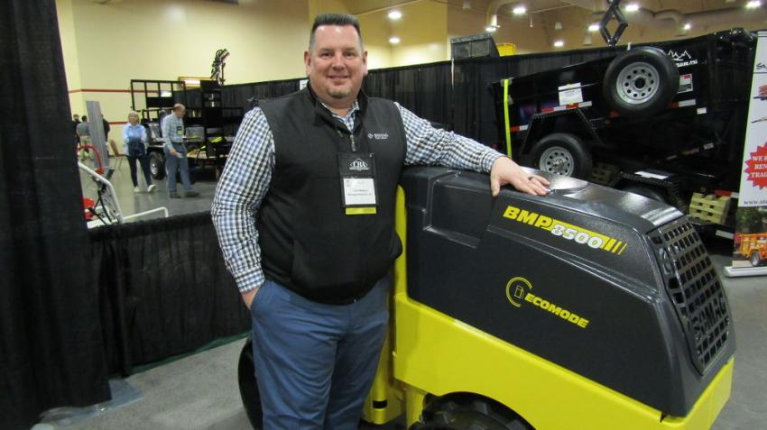 Known for its maneuverability in confined areas, the Bomag BMP8500 multi-purpose compactor is pictured here with Tom Watson of Bomag America's Inc.