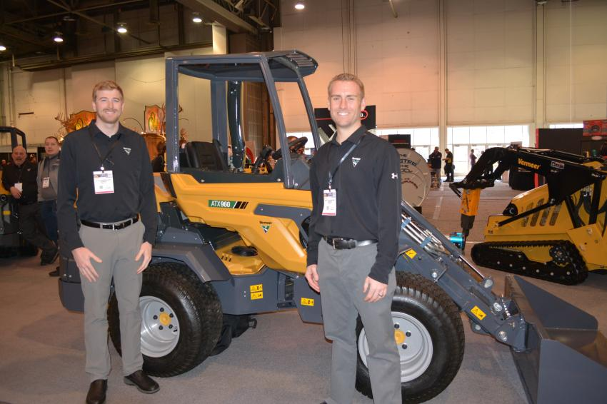 Vermeer's Kyle Newendorp (L), product specialist, and Matt Van Maanen, sales manager, display the company's newest offering, the ATX960 articulated loader, at World of Concrete.