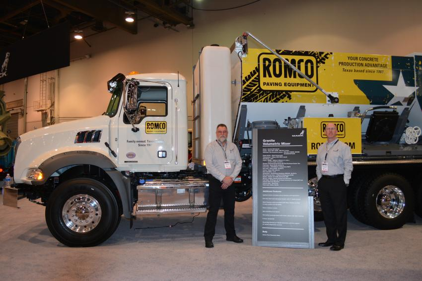 The ROMCO Equipment colors adorned this Mack Truck at the Mack exhibit in Central Hall. This Mack was equipped with a Cementech body and was delivered to ROMCO, Cemen Tech's dealer in Texas. Michael Goforth (L) works in the Body Builders support group at Mack and Richard Bollenbacher is district sales manager of the southeast.