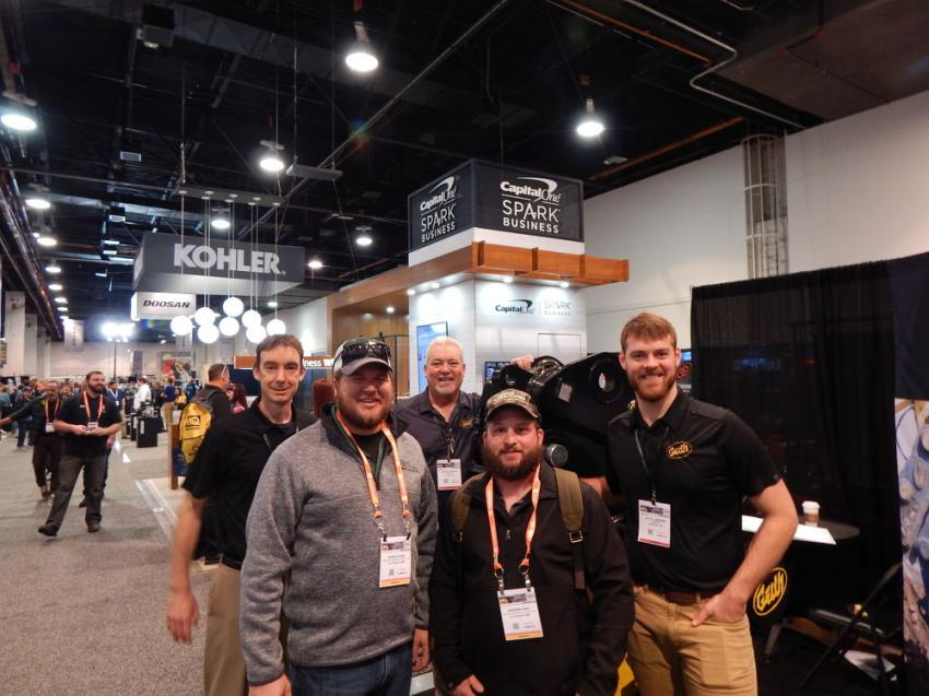 (L-R): At the Geith booth showing off its highly popular manual 25-ton crusher is Geith Sales Manager Adrian Kelly, Wieser Brothers General Contractor Adam Olson, La Crescent Minn., Johnny Demary, Geith district sales manager, Andrew Dahl, also with Wieser Brothers; and Kyle Lundeen, district sales manager.