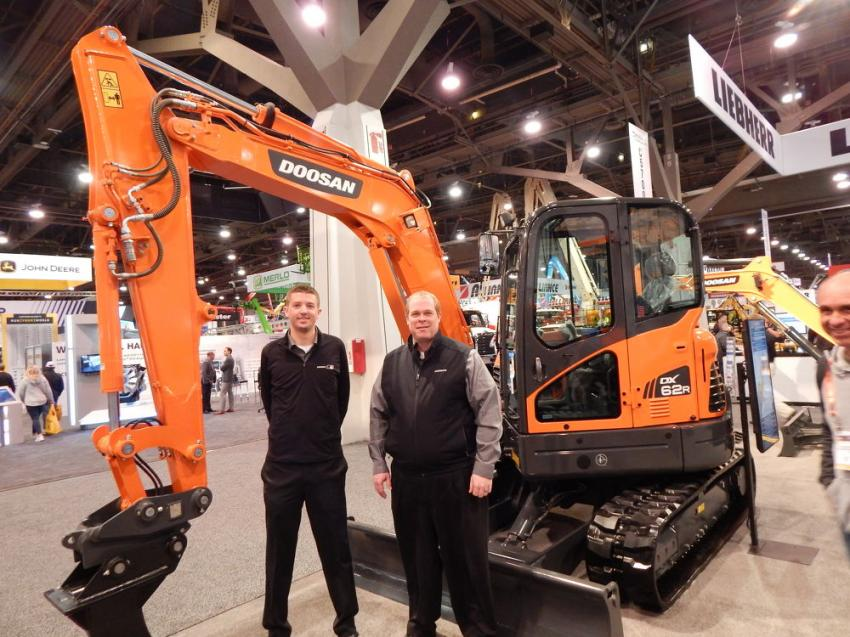 Nathan Cain (L), Doosan product specialist and Doosan Infracore North America Marketing Director Aaron Kleingartner display the Doosan DX 62 R excavator. Doosan has 13 crawler excavator models designed for heavy digging and lifting operations.