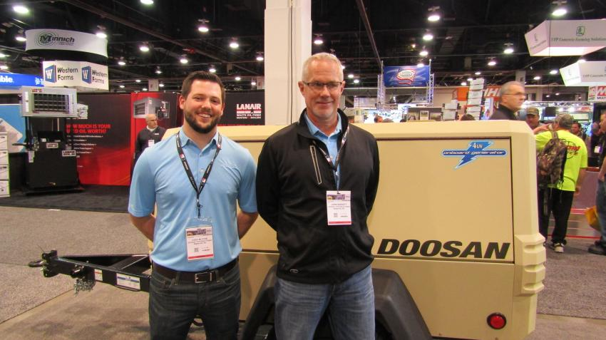 Cody Blythe (L) and John Hargett of Doosan-Portable Power of Statesville, N.C., present the XP185 air compressor. Shown here equipped with an optional 4RW generator to maximize job site productivity.