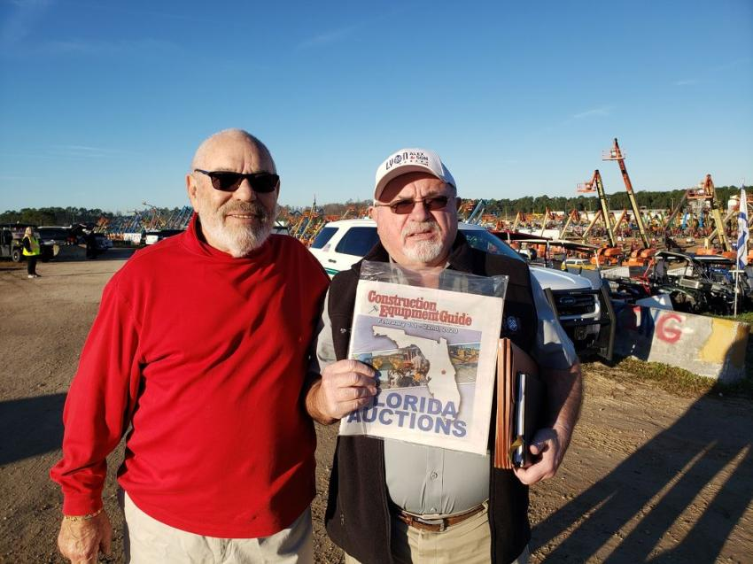 Mike Pearl (L) of Equipment Mart of N.Y. Inc. and Jack Lyon, president of Alex Lyon & Son, look over Construction Equipment Guide's Florida Auction issue featuring all the information you need to know on the 27th annual Florida Auctions in Kissimmee, Fla.