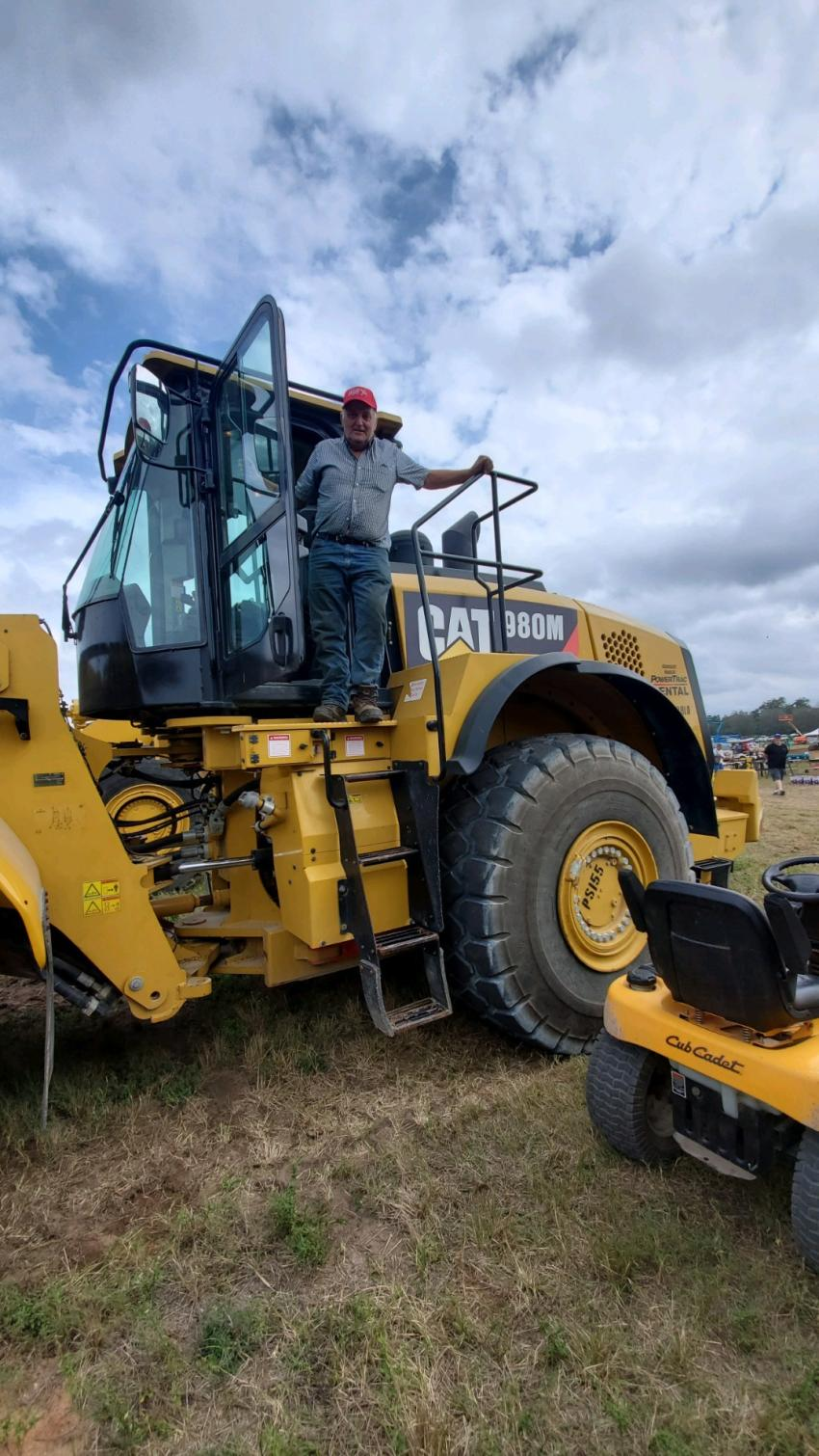 Roger Lottman, of Canajoharie, N.Y., owner of Lottman Excavation, looks over a Cat 980M wheel loader to possibly add to his fleet.