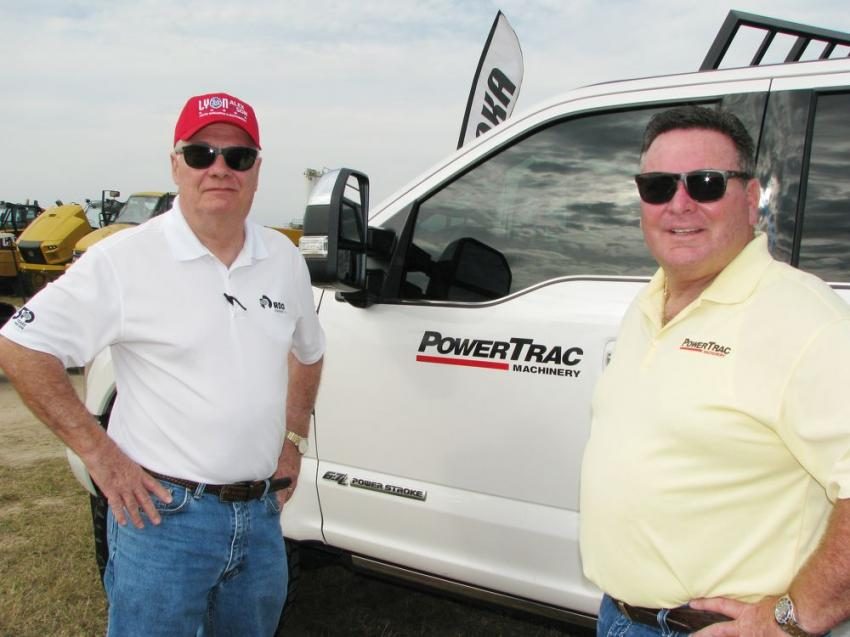 Terry North (L) of RDO Equipment and Mark Enck of PowerTrac-Miami talk about the machines about to be auctioned at the Lyon sale.