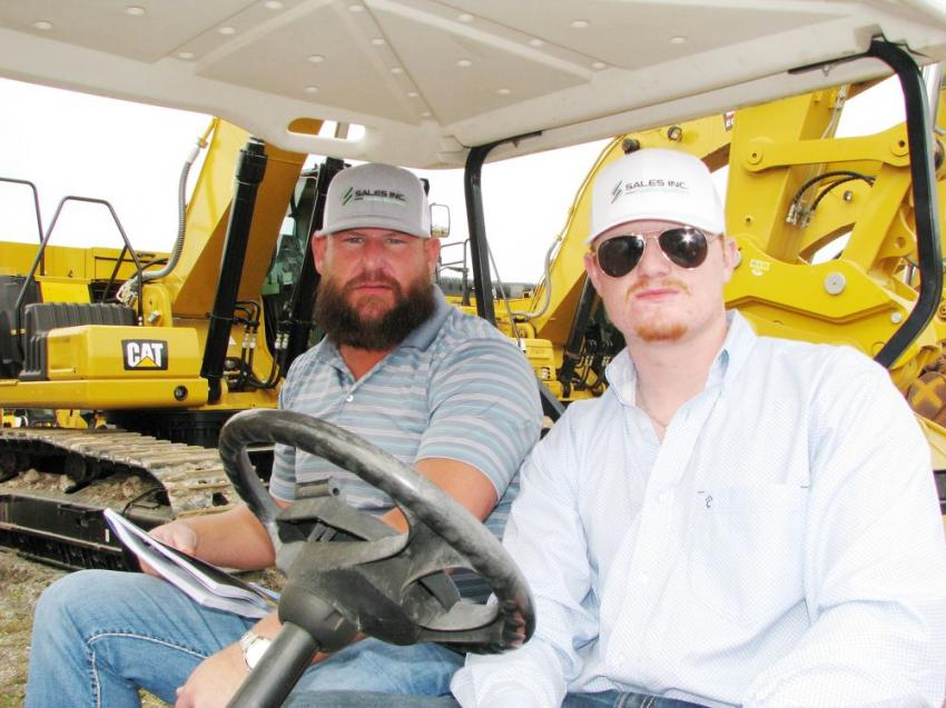 Barry Tarp (L) and Chase McGahey of Sales Inc.-Pipeline Machinery, Cheyenne, Wyo., were cruising the excavator section looking for machines of interest.