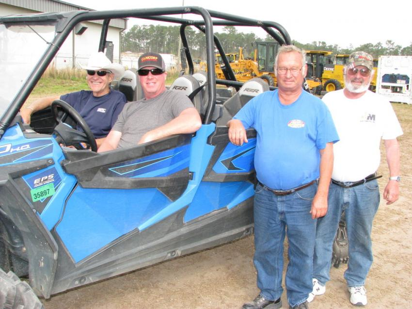 Guys from Maine enjoying their time in the sun at the auction included (L-R) Jim Pittman, Rent-It, Auburn, Maine; Doug Cameron, CamCorp Excavation, Brunswick, Maine; Les Leighton of Leighton's Garage and Wes Leighton of Leighton Excavation Co. Waterboro, Maine.