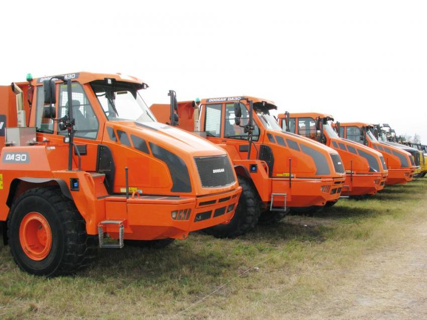 Four Doosan DA30 articulated dump trucks were cleaned and painted and showed well for the auction.
