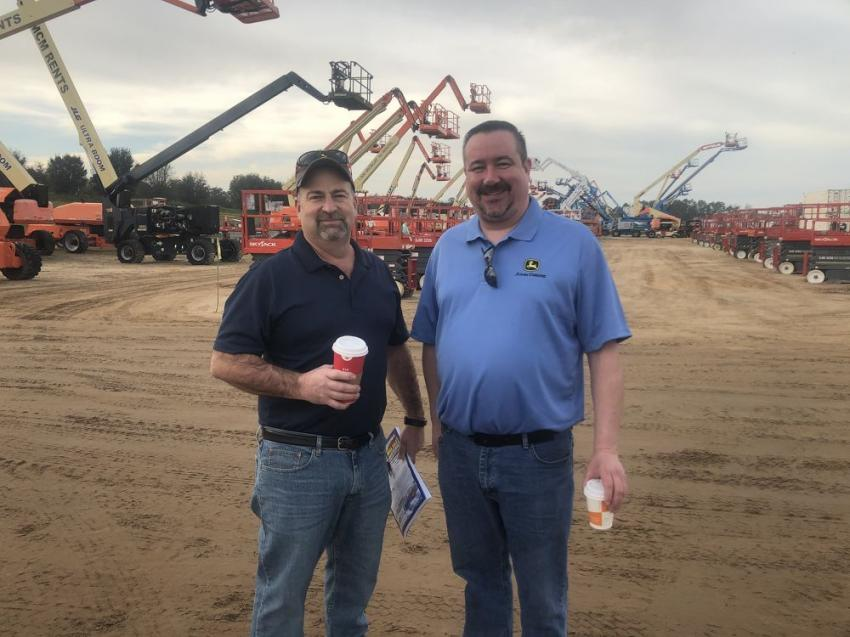 Jim Tirone (L), used equipment manager, and Greg Stascavage, used equipment coordinator, of Five Star Equipment, Dunmore, Pa., are ready to bid.