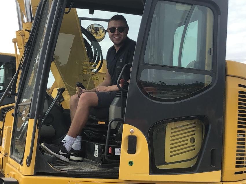 William Millar of Millar Tractors, Coleraine, Northern Ireland, checks out a Komatsu hydraulic excavator.