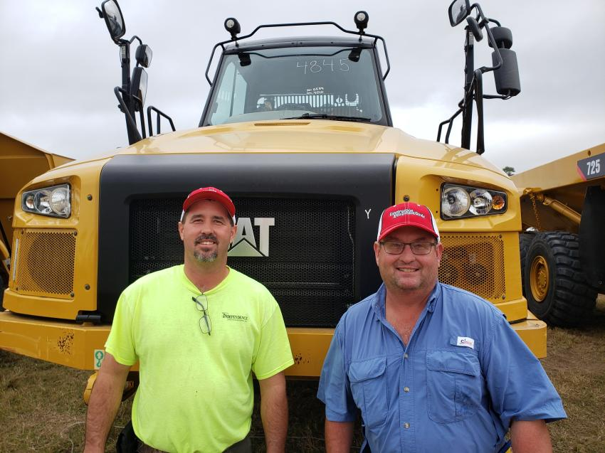 Showing off their CEG hats, Mike (L) and Jeff Small of Small Sand and Gravel in Gambier, Ohio, look over this Cat 730C articulated truck.
