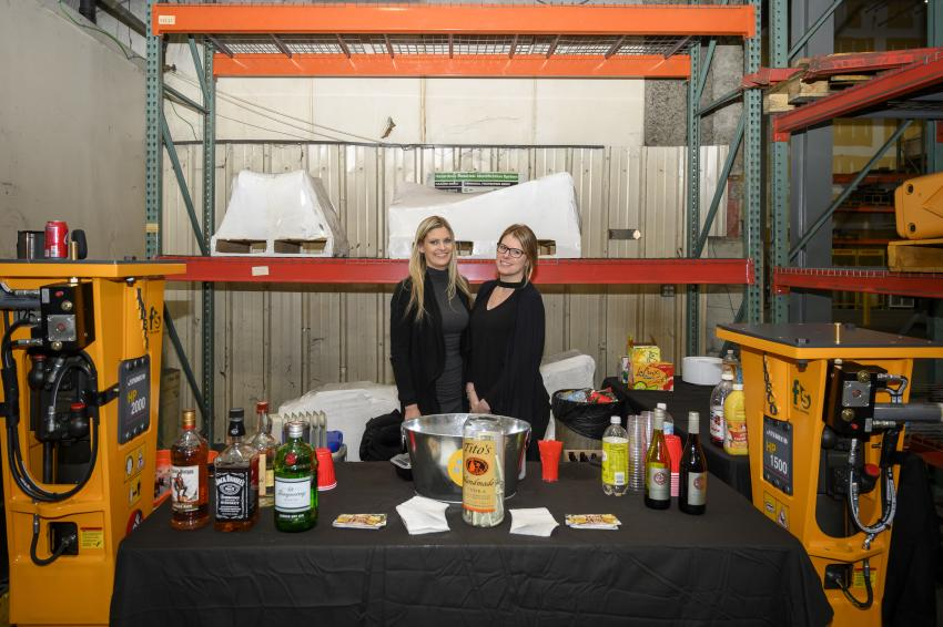 Aubrey and Jaime of The Orange Ale House and Grill provide drink services for guests.