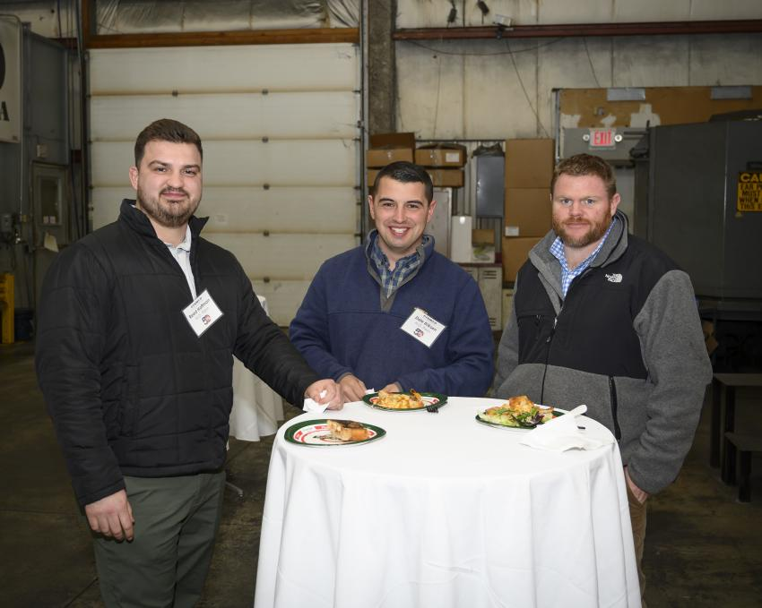 (L-R): Reed Hoffman, Dale Erikson and Dwight Burnham, all of H.O. Penn, enjoy the dinner provided by Grand A Pizza.