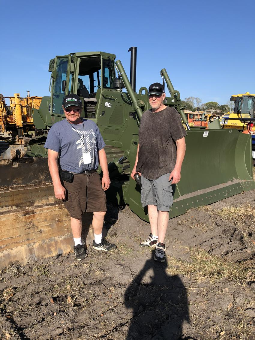 Todd Wendorf (L) and Dave Innes of Astec Asphalt, Brown City, Mich., tested this John Deere 850J dozer with 600 hours showing on the meter.