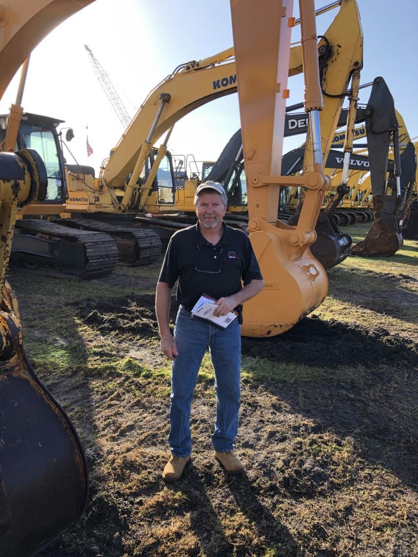 Dan McHugh of Brookside Equipment Sales came in from Phillipston, Mass., to review the excavators up for bid at the Jeff Martin Auctioneers' Kissimmee auction.