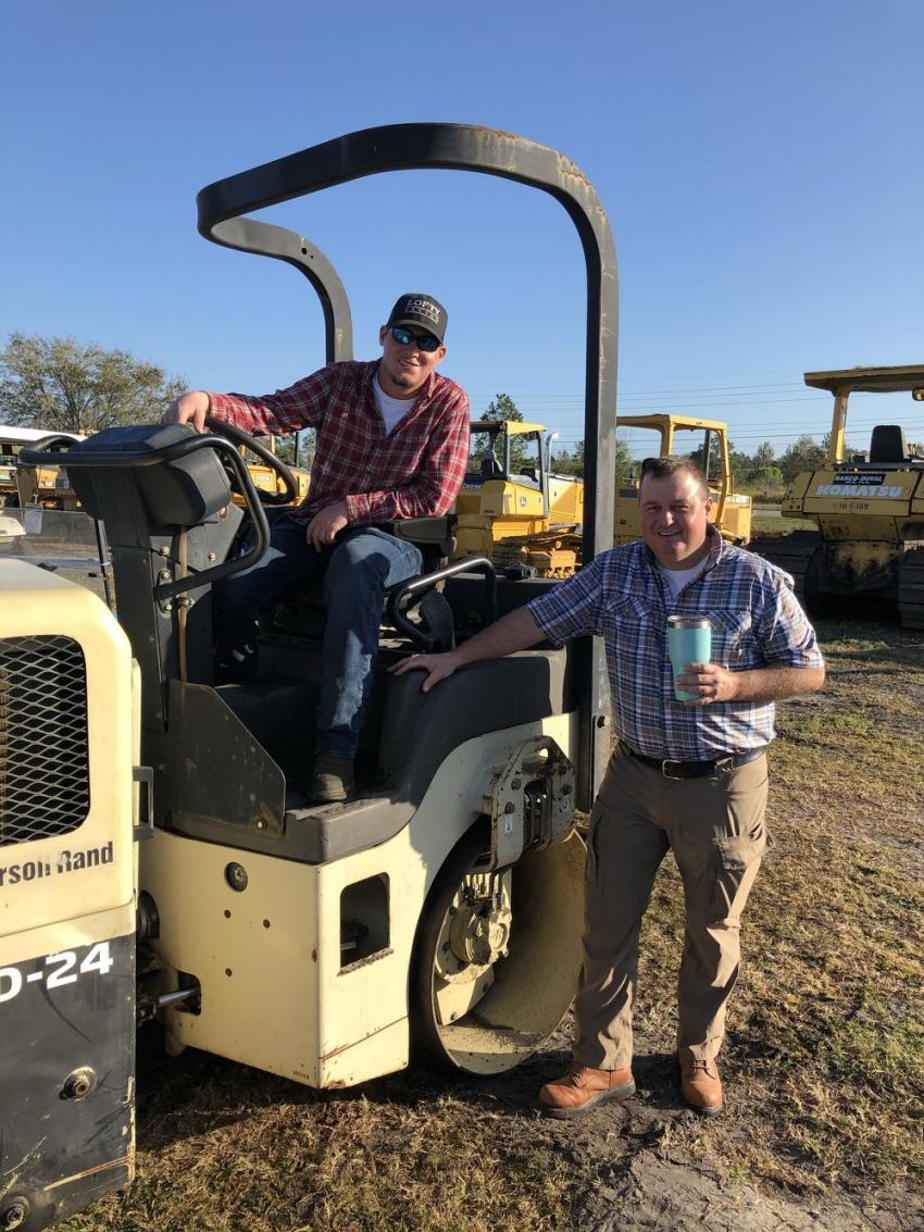 Brian (L) and Caleb Lofty of Lofty Paving, based in Dunlap, Tenn., give this Ingersoll Rand roller the once over while considering a bid.