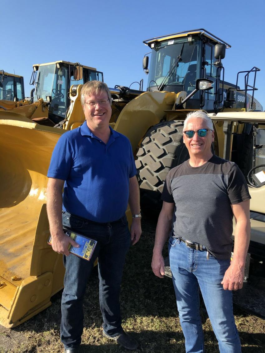 Jim Weber (L) and Ron Frost of Ohio Mulch were at the Jeff Martin Auctioneers Kissimmee auction in search of wheel loaders.