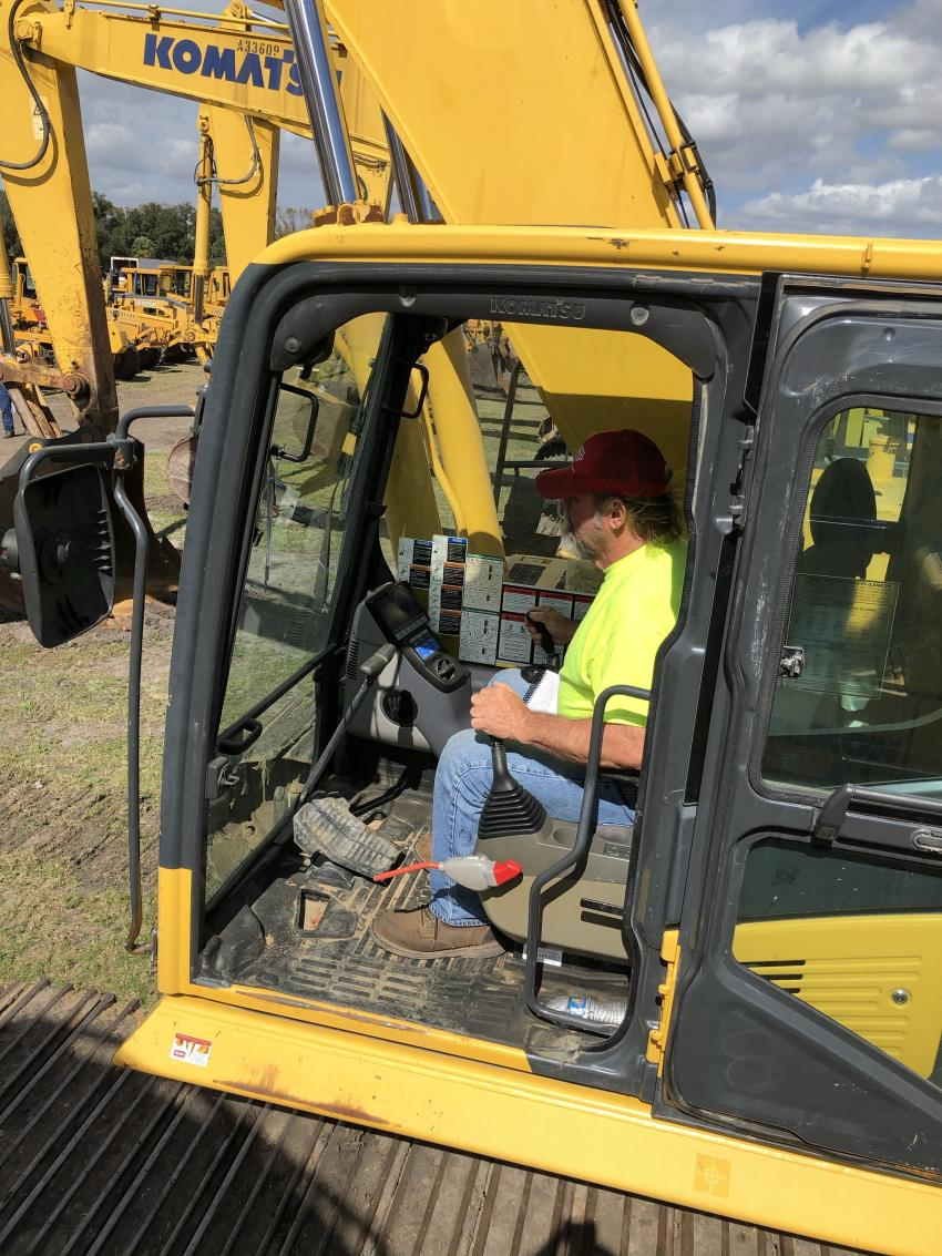 Steve Jordan of Steve's Stone & Contracting, based in Andrews, N.C., puts this Komatsu PC 360LC excavator through its paces at the auction.