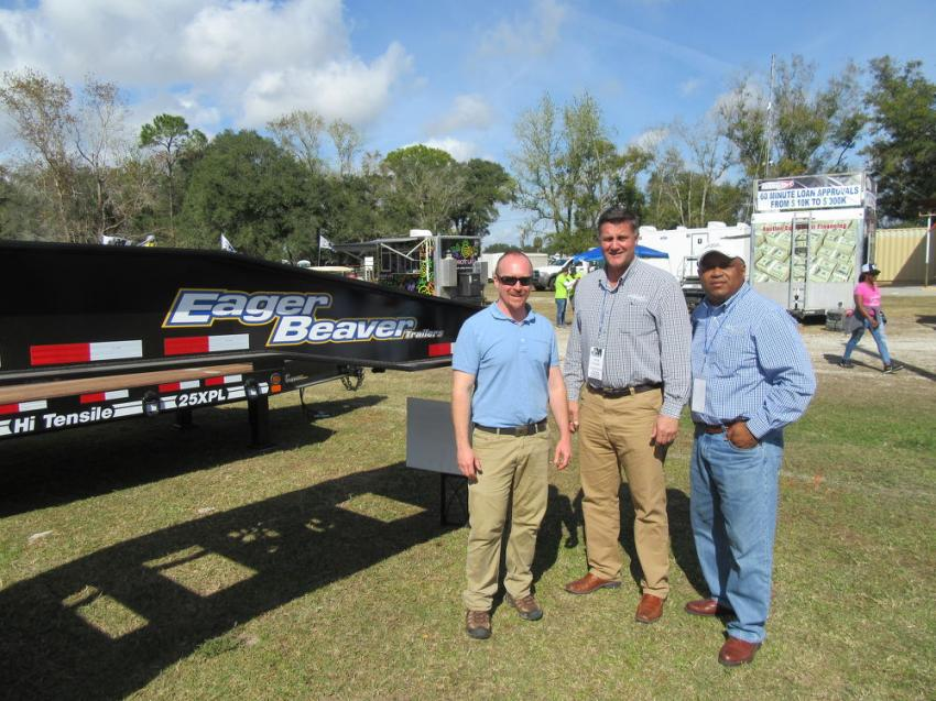 (L-R): Ben Flowers, Kevin Ferringer and Johnny Gomez of Eager Beaver Trailers were in the exhibit area at the Jeff Martin Auction in Kissimmee to talk about the company's line of trailers.