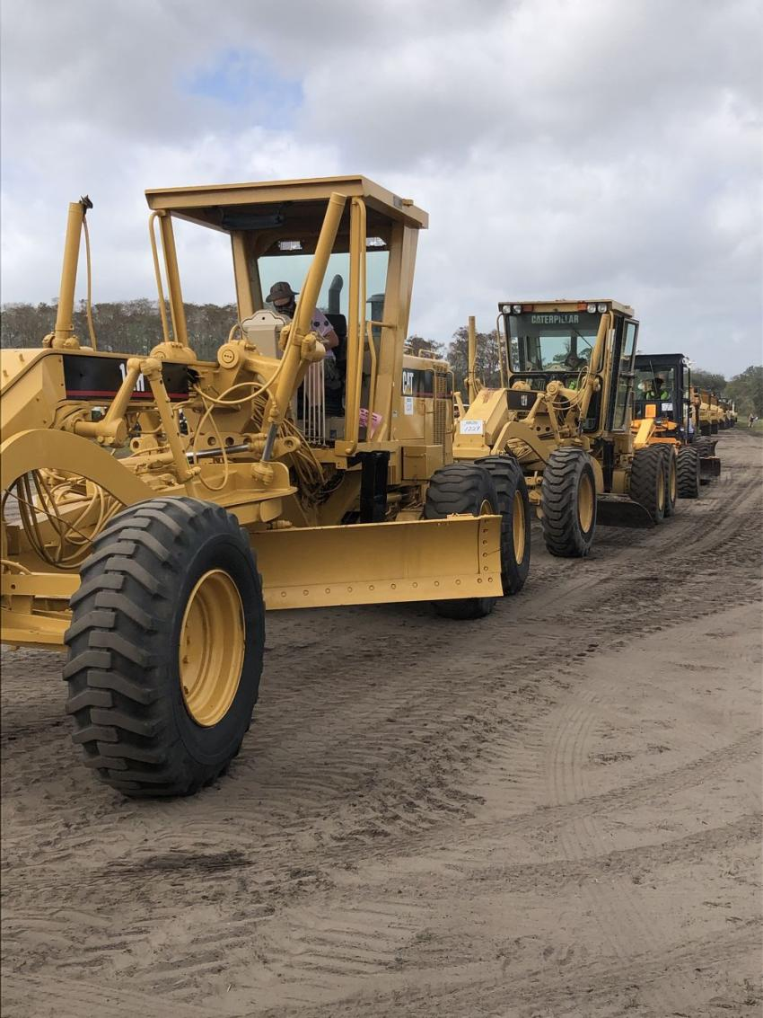 Motor graders line up to run over the ramp at this year's Yoder & Frey Kissimmee, Fla., February sale.
