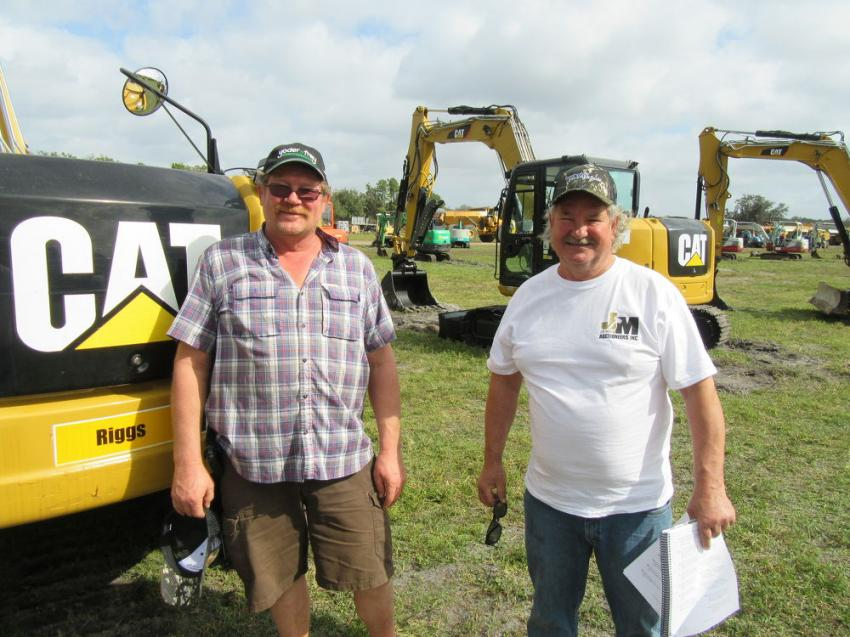 Todd Wendorf (L) of Astec Asphalt and Ron Trombley of Trombleys Excavating, both located in Brown City, Mich., were in search of mini-excavators at the Yoder & Frey auction.
