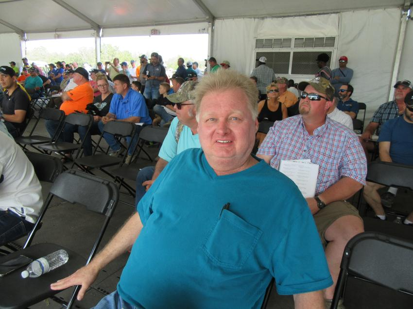 Danny Clark of Clark Heavy Equipment, based in Pleasureville, Ky., takes in the bidding activity at the Yoder & Frey auction.