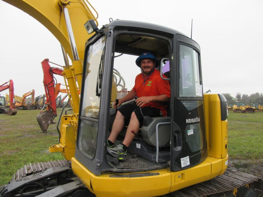Interested in both buying and selling machines at the Yoder & Frey auction, Chris Coleman of Coleman Recycling, based in Lake Wells, Fla., tries out a Komatsu PC138USLC excavator.