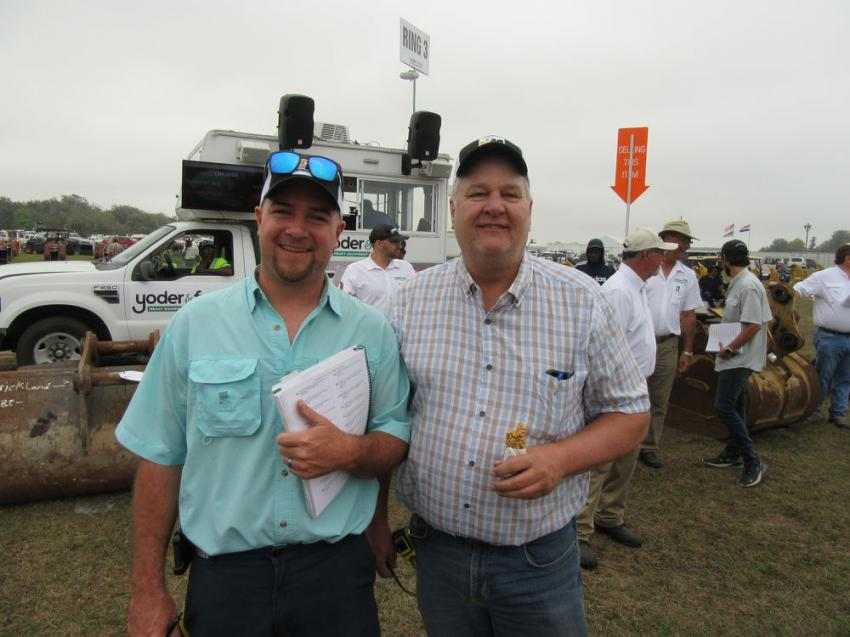 Aaron Geurink (L) of Holland Equipment Services, based in Holland, Mich., was joined by his father-in-law, Wayne DeYoung of Great Lakes Excavating Services, based in Milwakee, Wisc., to bid on attachments at the Yoder & Frey auction.