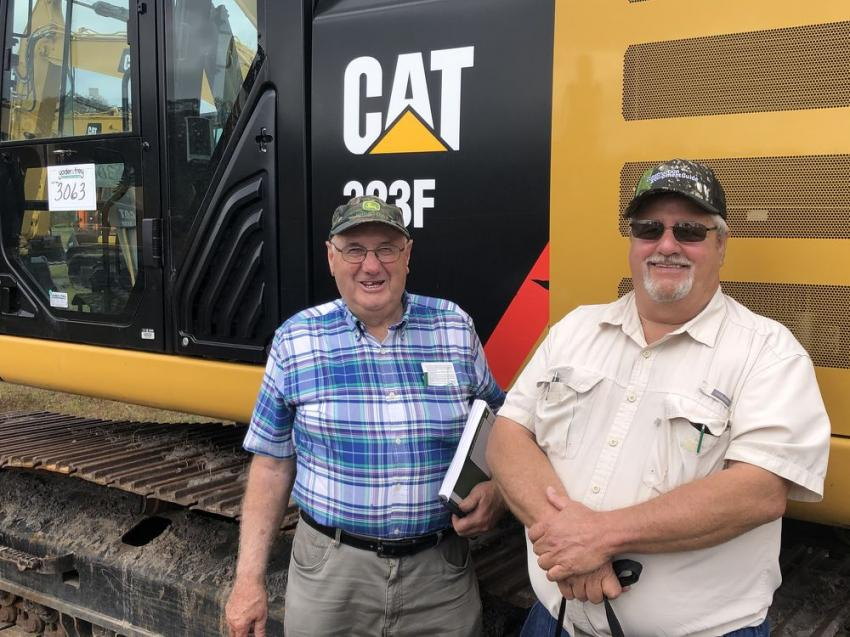 Gary McCormick (L) from Nova Scotia, Canada, owns a non-profit construction company called Ray McCormick & Sons. Alan Trombley of Trombley Construction, from Presque Isle, Maine, stands next to McCormick.