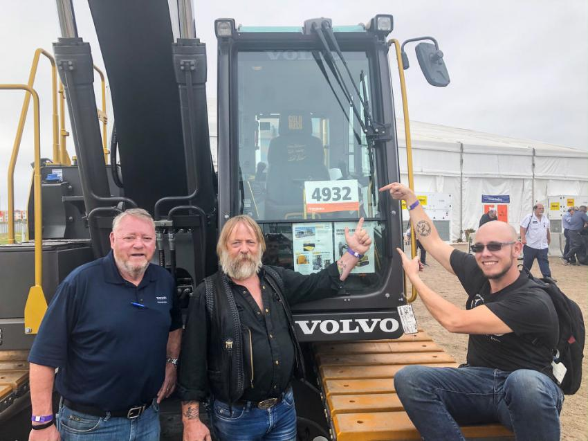 (L-R): Ian Harvey, director product marketing and communications of Volvo Construction Equipment & Services; and Tony and Kevin Beets of Discovery's Gold Rush were on hand at teh auction to see the Gold Rush EC200E excavator sold to an online buyer from Belgium for $290,000.