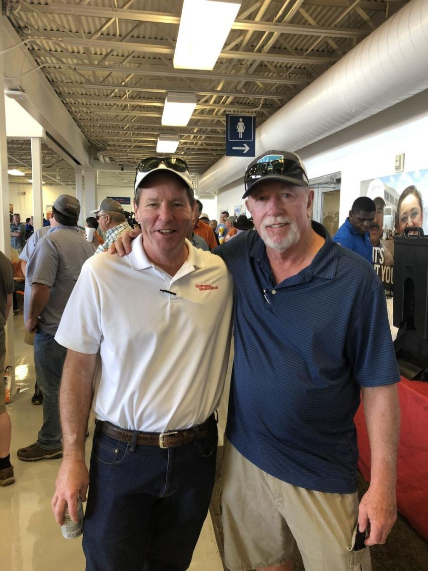 Ted McKeon (L), president of Construction Equipment Guide, catches up with Mike Sherman, recently retired used equipment manager of Milton Cat. Maybe it was the warm Florida sunshine or the lure of  Ritchie Bros.' annual February sale that drew Sherman back to Florida.