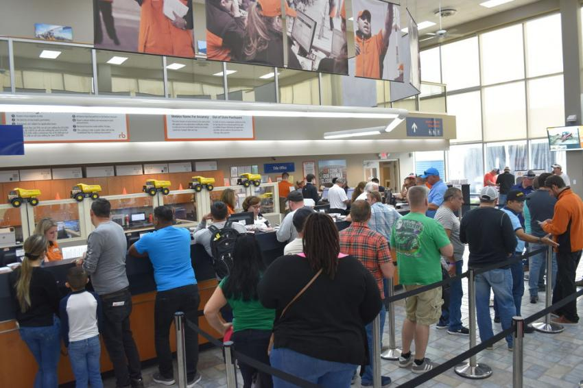 As the sale is set to begin, bidders line up to register. Lines, however, are not as long as they once were because Ritchie has developed many easy ways to register in advance, including the intuitive Ritchie Bros. app.